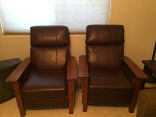 2 craftsman-style reclining chairs.